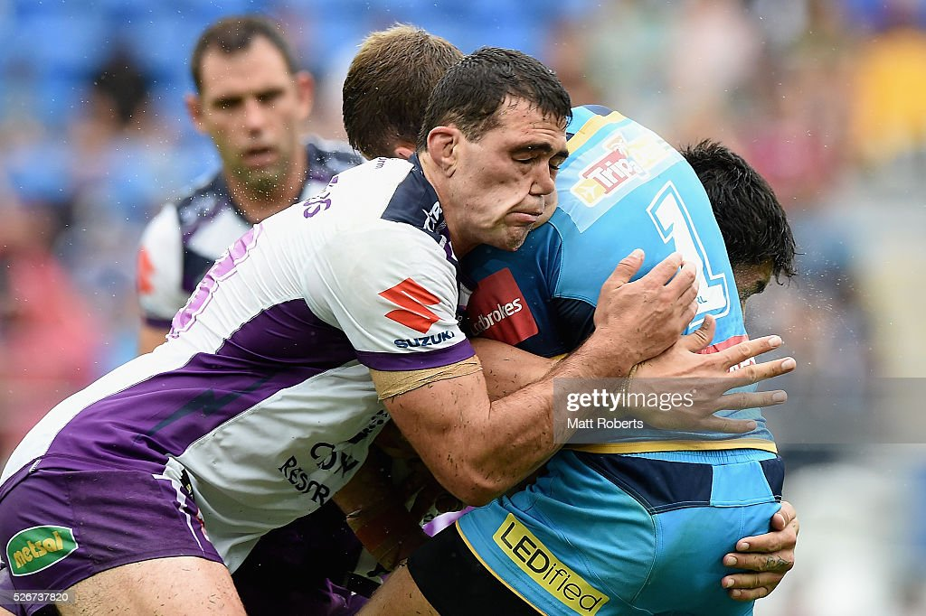Dale Finucane of the Storm tackles William Zillman of the Titans during the round nine NRL match between the Gold Coast Titans and the Melbourne Storm on May 1, 2016 in Gold Coast, Australia.