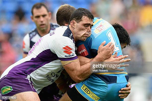 Dale Finucane of the Storm tackles William Zillman of the Titans during the round nine NRL match between the Gold Coast Titans and the Melbourne...