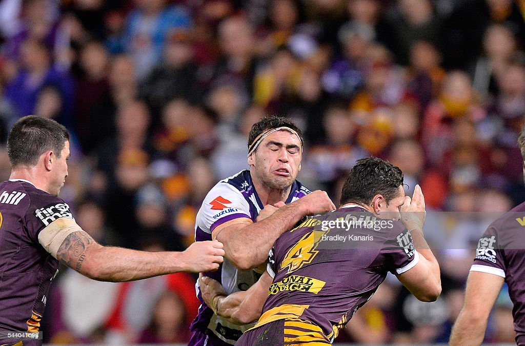 Dale Finucane of the Storm takes on the defence during the round 17 NRL match between the Brisbane Broncos and the Melbourne Storm at Suncorp Stadium on July 1, 2016 in Brisbane, Australia.