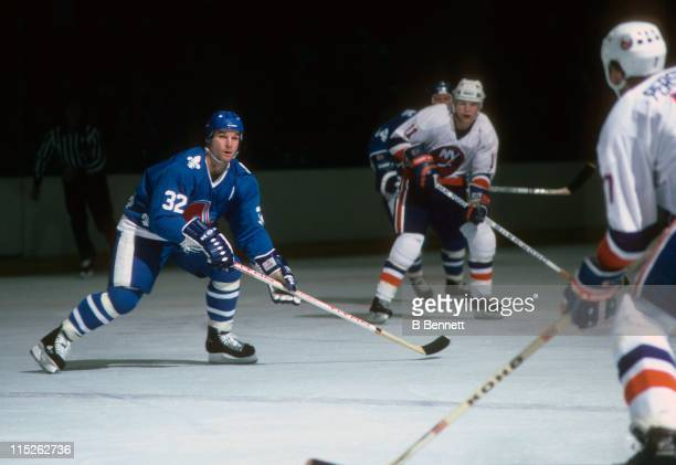 Dale Hunter of the Quebec Nordiques looks to block the pass from Stefan Persson of the New York Islanders on October 24 1985 at the Nassau Coliseum...