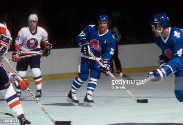 Dale Hunter of the Quebec Nordiques skates on the ice during an NHL game against the New York Islanders on October 24 1985 at the Nassau Coliseum in...