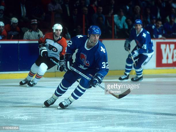 Dale Hunter of the Quebec Nordiques skates on the ice during an Eastern Conference Finals playoff game against the Philadelphia Flyers in May 1985 at...