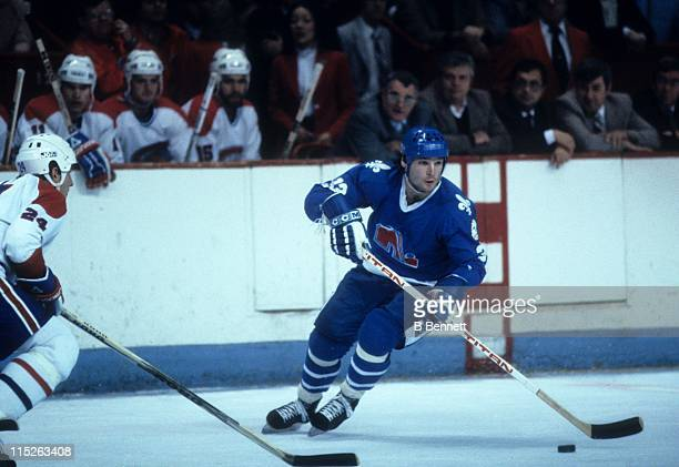 Dale Hunter of the Quebec Nordiques skates with the puck during an NHL game against the Montreal Canadiens circa 1982 at the Montreal Forum in...