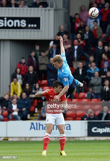 Dale Jennings of Barnsley tackles Tom Lees of Leeds United during the Sky Bet Championship match between Barnsley and Leeds United at Oakwell on...