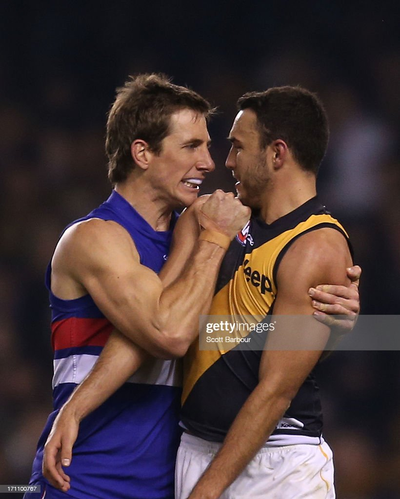 Dale Morris of the Bulldogs and Shane Edwards of the Tigers wrestle during the round 13 AFL match between the Western Bulldogs and the Richmond Tigers at Etihad Stadium on June 22, 2013 in Melbourne, Australia.