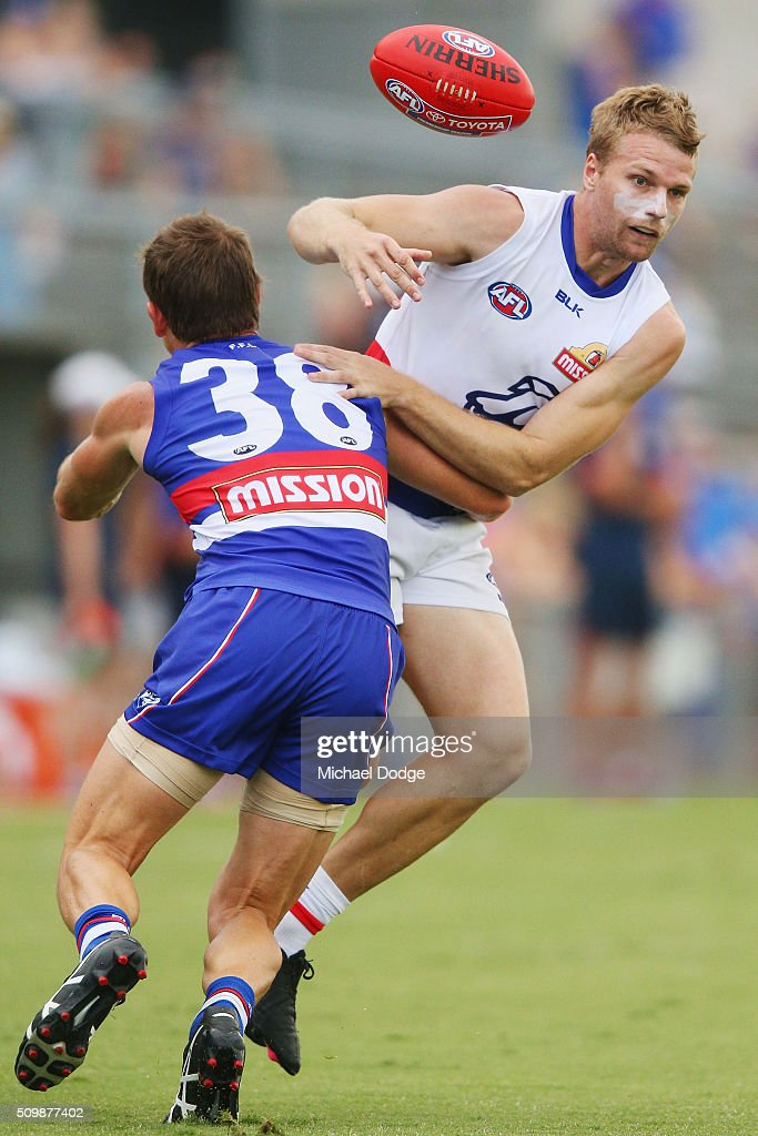 Dale Morris of the Bulldogs tackles Jake Stringer of the Bulldogs during the Western Bulldogs AFL intra-club match at Whitten Oval on February 13, 2016 in Melbourne, Australia.