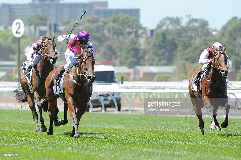 Dale Smith riding Loveyamadly (L) wins the Mrs Mac's Beef Pie Sprint during Melbourne Racing at Flemington Racecourse on March 2, 2013 in Melbourne, Australia.