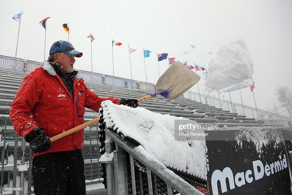 Dale Smith shovels snow from the finish line grandstand as downhill training for the Birds of Prey Audi FIS Ski World Cup was cancelled due to excessive snow on December 4, 2013 in Beaver Creek, Colorado.