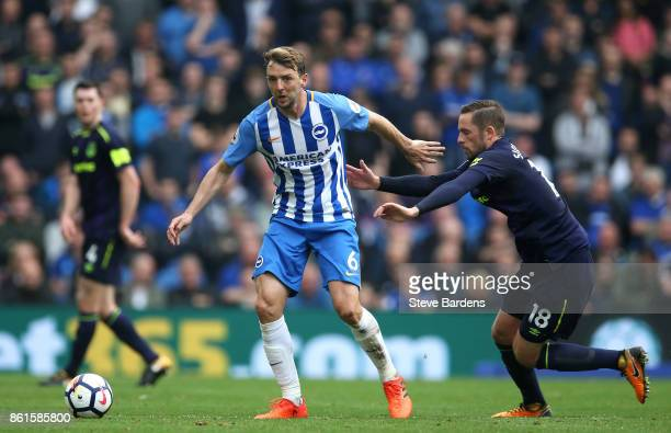 Dale Stephens of Brighton and Hove Albion and Gylfi Sigurdsson of Everton during the Premier League match between Brighton and Hove Albion and...