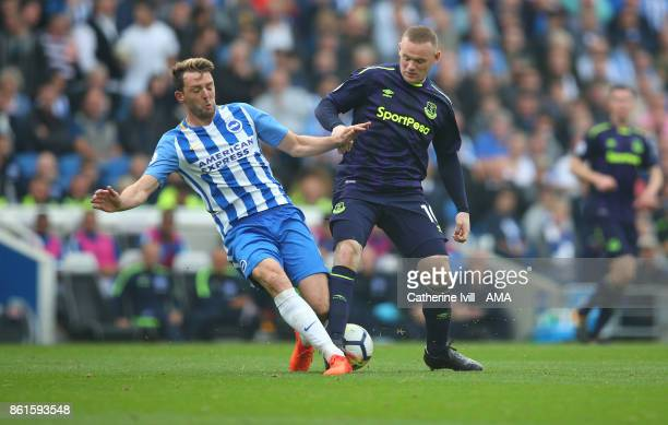 Dale Stephens of Brighton and Hove Albion and Wayne Rooney of Everton during the Premier League match between Brighton and Hove Albion and Everton at...