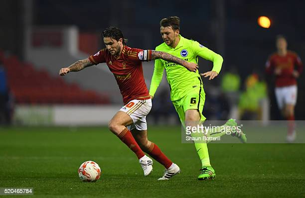 Dale Stephens of Brighton and Hove Albion chases down Henri Lansbury of Nottingham Forest during the Sky bet Championship match between Nottingham...