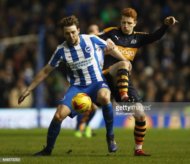 Dale Stephens of Brighton and Hove Albion tussles with Jack Colback of Newcastle United during the Sky Bet Championship match between Brighton Hove...