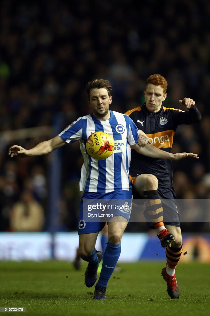 Dale Stephens of Brighton and Hove Albion tussles with Jack Colback of Newcastle United during the Sky Bet Championship match between Brighton & Hove Albion and Newcastle United at the Amex Stadium on February 28, 2017 in Brighton, England.