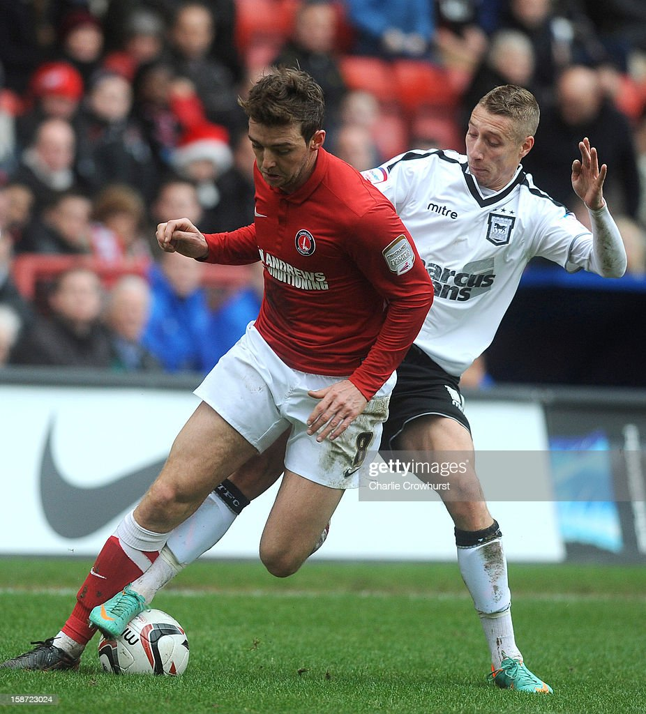 Dale Stephens of Charlton Athletic gets passed <a gi-track='captionPersonalityLinkClicked' href=/galleries/search?phrase=Lee+Martin+-+Soccer+Player+-+Born+1987&family=editorial&specificpeople=15382346 ng-click='$event.stopPropagation()'>Lee Martin</a> of Ipswich during the npower Championship match between Charlton Athletic and Ipswich Town at The Valley on December 26, 2012 in London, England.