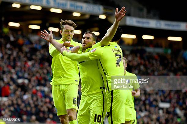 Dale Stephens Tomer Hemed and Beram Kayal of Brighton and Hove Albion celebrate after scoring the first goal during the Sky Bet Championship match...