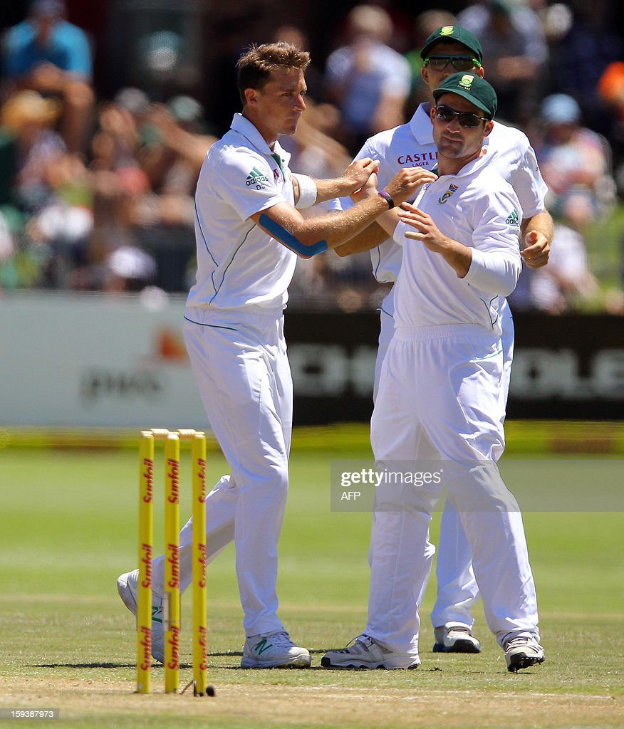 Dale Steyn (L) and Dean Elgar of South Africa celebrate Doug Bracewell's wicket on the third day of the second and final test match between South Africa and New Zealand at the Axxess St George's Cricket Stadium on January 13, 2013 in Port Elizabeth. AFP Photo / Anesh Debiky