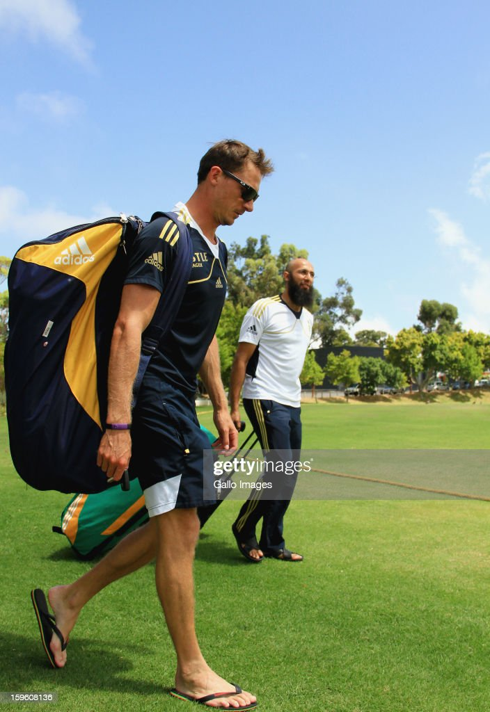 Dale Steyn (L) and Hashim Amla arrive at the South African national cricket team nets session and press conference at Claremont Cricket Club on January 17, 2013 in Cape Town, South Africa.