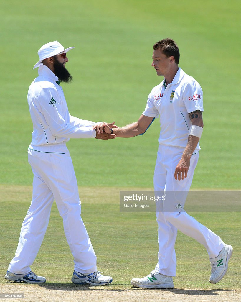 <a gi-track='captionPersonalityLinkClicked' href=/galleries/search?phrase=Dale+Steyn&family=editorial&specificpeople=649553 ng-click='$event.stopPropagation()'>Dale Steyn</a> and <a gi-track='captionPersonalityLinkClicked' href=/galleries/search?phrase=Hashim+Amla&family=editorial&specificpeople=647392 ng-click='$event.stopPropagation()'>Hashim Amla</a> of South Africa celebrate victory during day 4 of the 2nd Test match between South Africa and New Zealand at Axxess St Georges on January 14, 2013 in Port Elizabeth, South Africa.