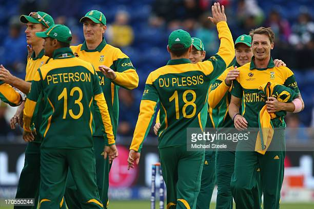 Dale Steyn of South Africa accepts the congratulations from team mates after capturing the wicket of Johnson Charles of West Indies during the ICC...