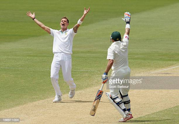 Dale Steyn of South Africa appeals successfully for the dismissal of Michael Clarke of Australia as Michael Hussey of Australia gestures during day...
