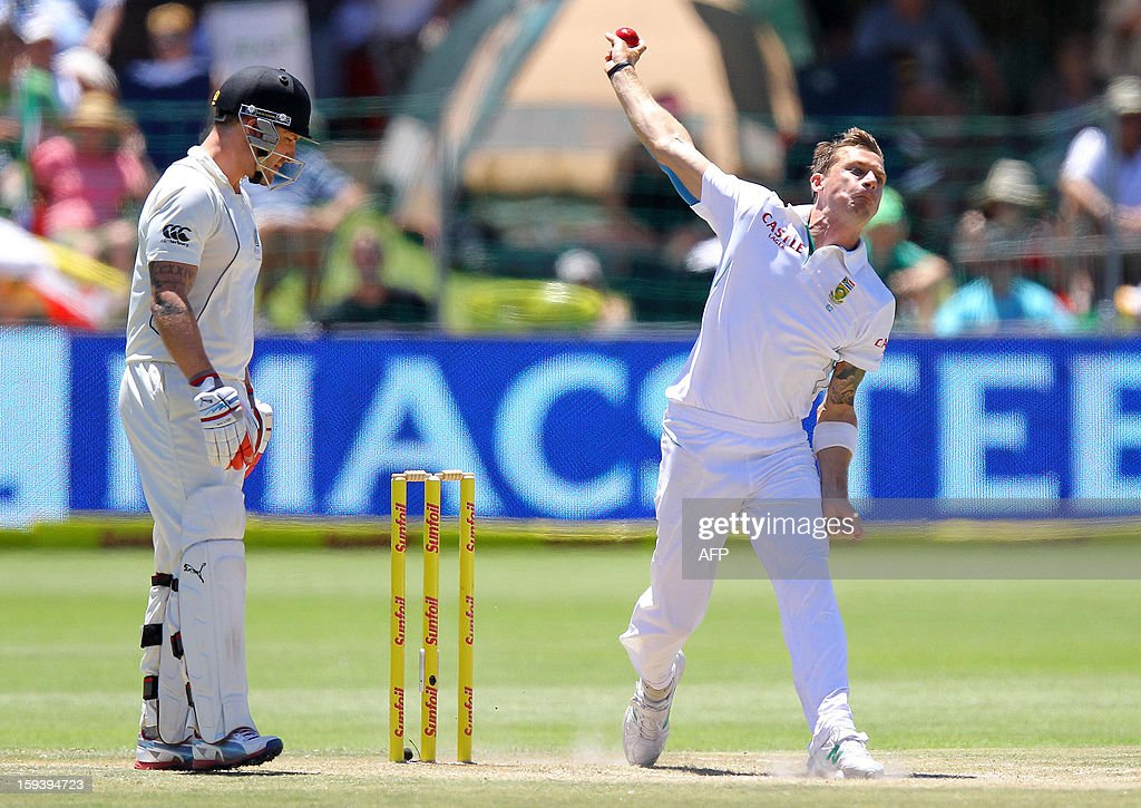 Dale Steyn (R) of South Africa bowls as Brendon McCullum of New Zealand (L) looks on, on the third day of the second and final test match between South Africa and New Zealand at the Axxess St George's Cricket Stadium on January 13, 2013 in Port Elizabeth. AFP Photo / Anesh Debiky