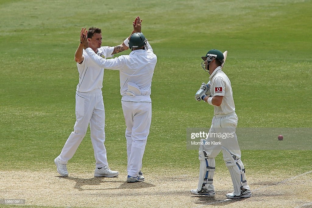 Dale Steyn (L) of South Africa celebrates as Michael Clarke of Australia leaves the field after getting out during day four of the Second Test Match between Australia and South Africa at Adelaide Oval on November 25, 2012 in Adelaide, Australia.