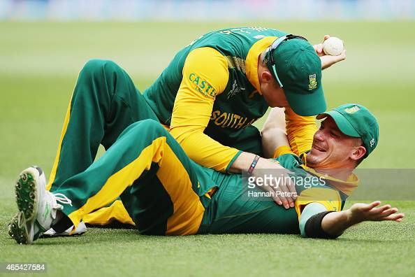 Dale Steyn of South Africa celebrates with David Miller of South Africa after taking a catch to dismiss Ahmad Shahzad of Pakistan during the 2015 ICC...