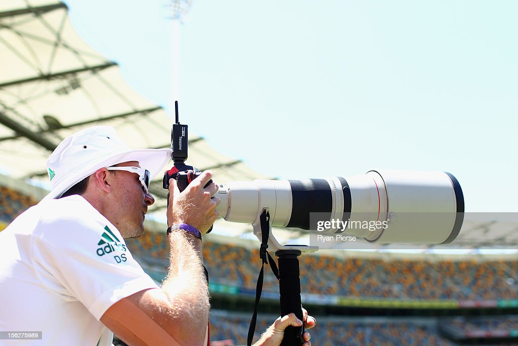 <a gi-track='captionPersonalityLinkClicked' href=/galleries/search?phrase=Dale+Steyn&family=editorial&specificpeople=649553 ng-click='$event.stopPropagation()'>Dale Steyn</a> of South Africa looks through a photographers camera during day five of the First Test match between Australia and South Africa at The Gabba on November 13, 2012 in Brisbane, Australia.