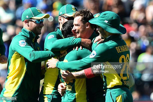 Dale Steyn of the Proteas celebrates the wicket of Steven Smith of Australia with hiis team mates during the 2nd Momentum ODI Series match between...