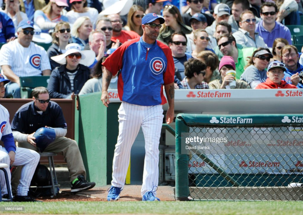Dale Sveum #4 of the Chicago Cubs makes a pitching change during the eighth inning against the Cincinnati Reds on May 4, 2013 at Wrigley Field in Chicago, Illinois.