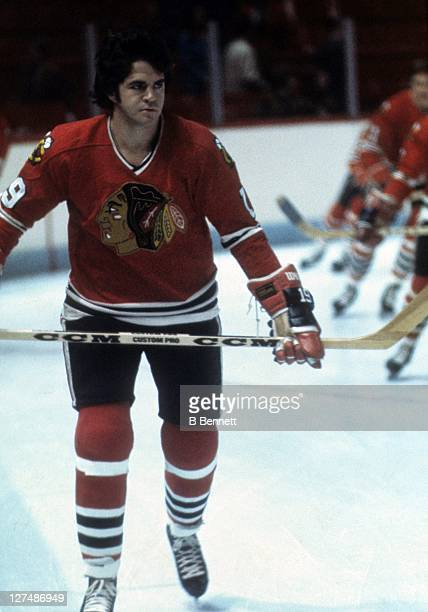 Dale Tallon of the Chicago Blackhawks skates on the ice before an NHL game against the Montreal Canadiens circa 1976 at the Montreal Forum in...