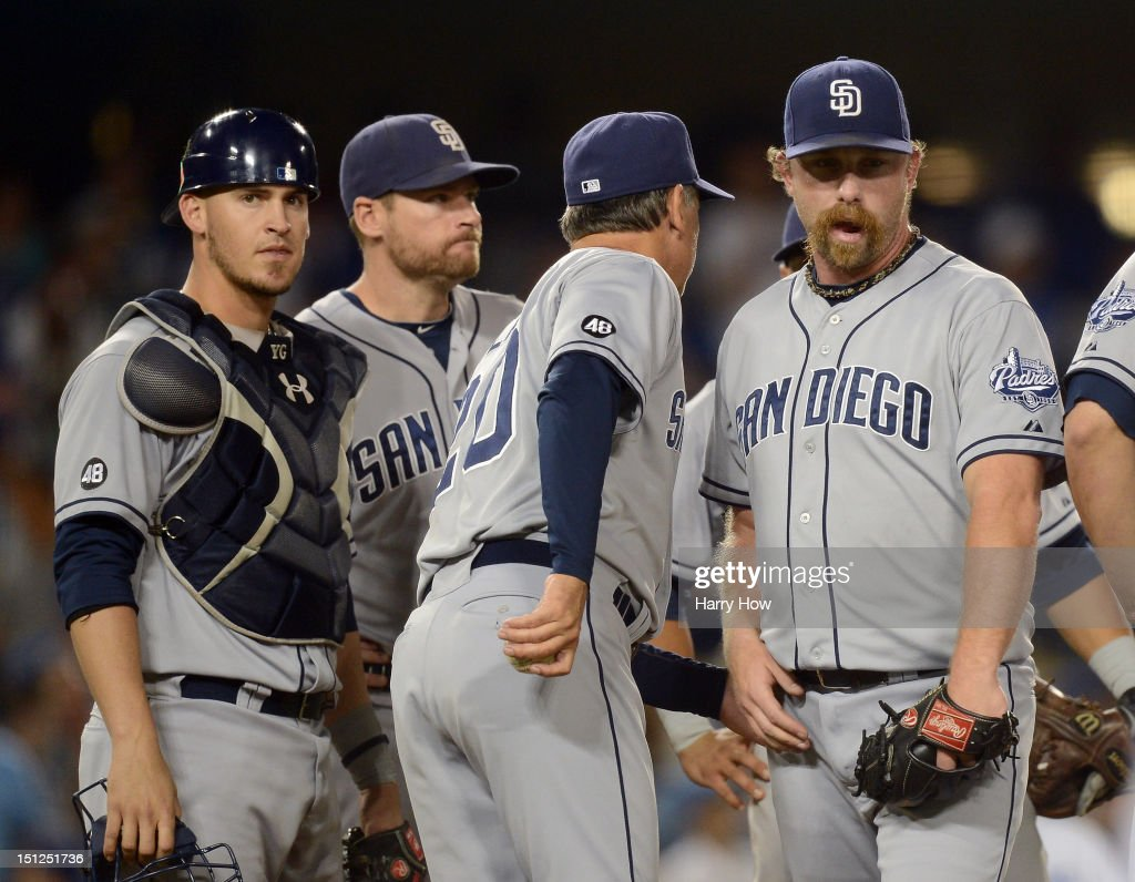 Dale Thayer #55 of the San Diego Padres leaves the mound in front of Manager Bud Black, Yasmani Grandal #12 and Chase Headley #7 after giving up a run for a 2-1 lead to the Los Angeles Dodgers during the seventh inning at Dodger Stadium on September 4, 2012 in Los Angeles, California.
