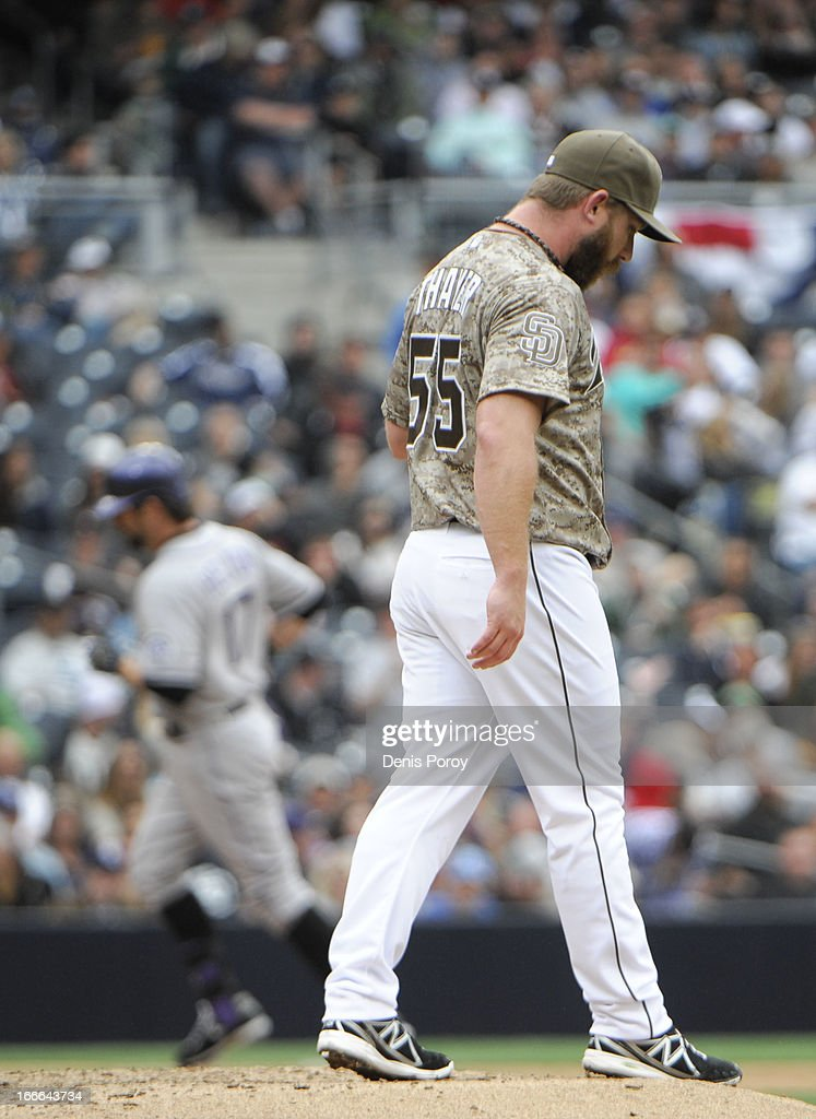 Dale Thayer #55 of the San Diego Padres looks to the outfield as <a gi-track='captionPersonalityLinkClicked' href=/galleries/search?phrase=Todd+Helton&family=editorial&specificpeople=200735 ng-click='$event.stopPropagation()'>Todd Helton</a> #17 of the Colorado Rockies rounds the bases after he hit a two-run homer during the seventh inning of a baseball game at Petco Park on April 14, 2013 in San Diego, California. The Rockies won 2-1.