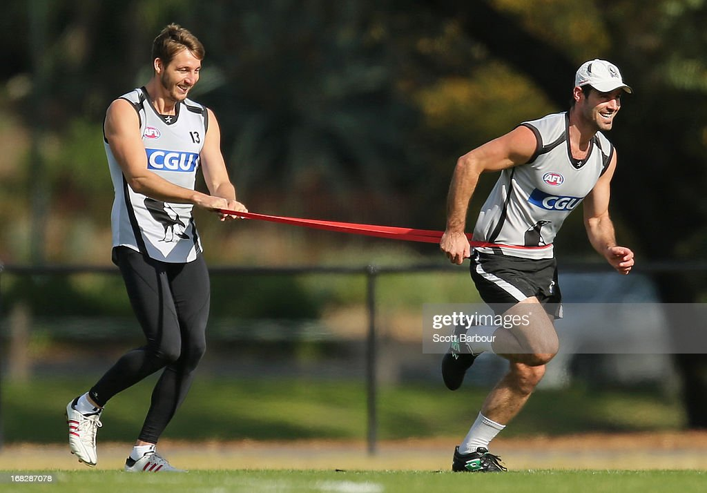 Dale Thomas and Alan Didak of the Magpies run during a Collingwood Magpies AFL training session at Olympic Park on May 8, 2013 in Melbourne, Australia.