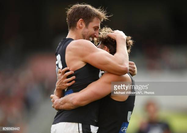 Dale Thomas and Charlie Curnow of the Blues celebrate during the 2017 AFL round 20 match between the Essendon Bombers and the Carlton Blues at the...