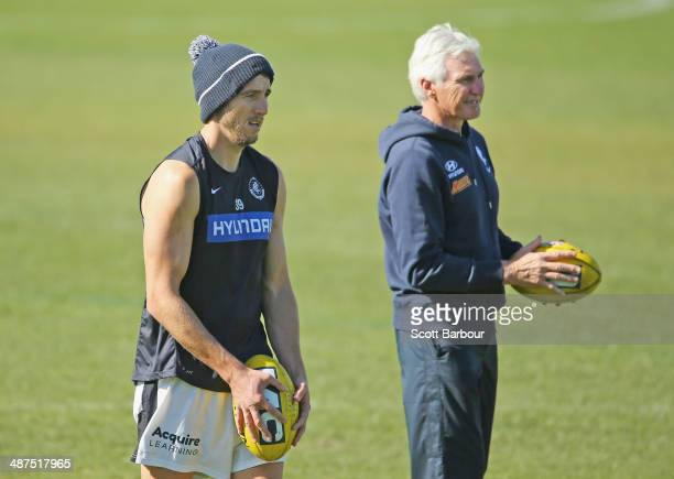 Dale Thomas and Mick Malthouse coach of the Blues look on during a Carlton Blues AFL training session at Visy Park on May 1 2014 in Melbourne...