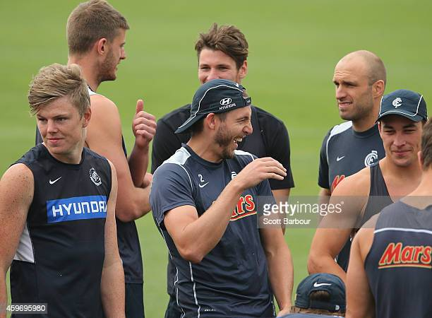 Dale Thomas laughs as Chris Judd looks on during a Carlton Blues AFL preseason training session at Visy Park on November 29 2014 in Melbourne...