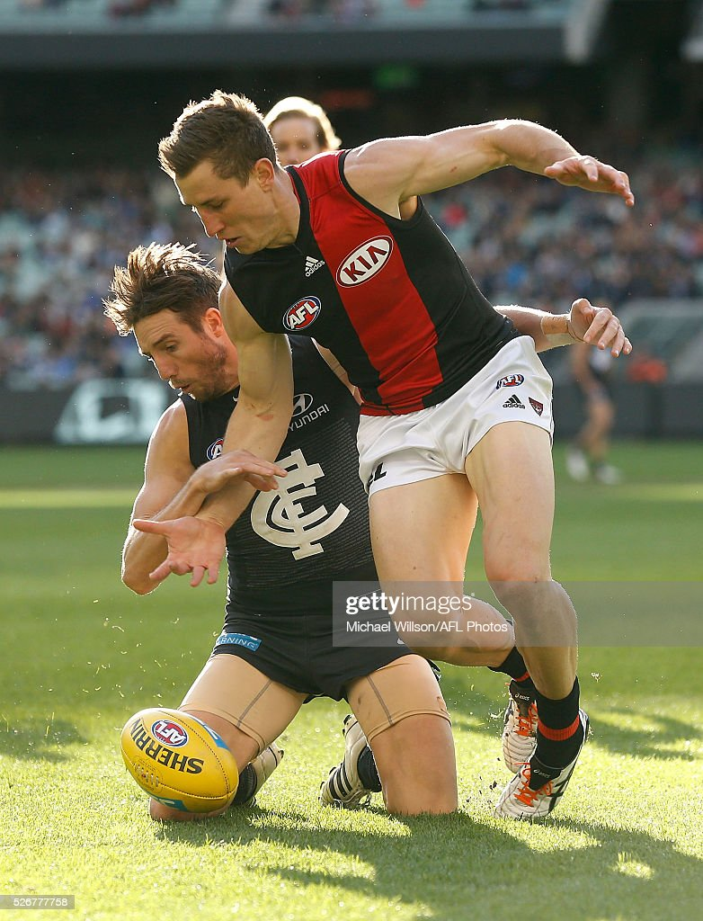 Dale Thomas of the Blues and James Polkinghorne of the Bombers compete for the ball during the 2016 AFL Round 06 match between the Carlton Blues and the Essendon Bombers at the Melbourne Cricket Ground, Melbourne on May 1, 2016.