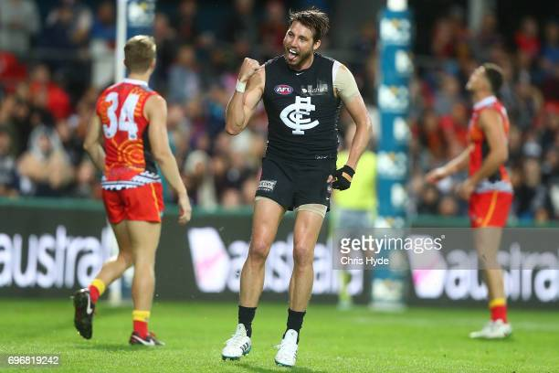 Dale Thomas of the Blues celebrates a goal during the round 13 AFL match between the Gold Coast Suns and the Carlton Blues at Metricon Stadium on...