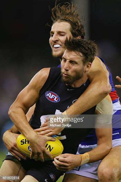 Dale Thomas of the Blues is tackled by Marcus Bontempelli of the Bulldogs during AFL Round 4 match between the Carlton Blues and the Western Bulldogs...