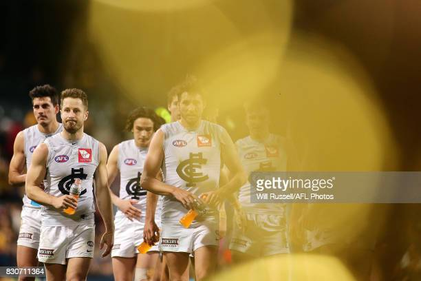 Dale Thomas of the Blues leaves the field after the teams defeat during the round 21 AFL match between the West Coast Eagles and the Carlton Blues at...