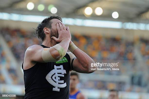 Dale Thomas of the Blues looks dejected after an attempt at goal during the round 21 AFL match between the Brisbane Lions and the Carlton Blues at...