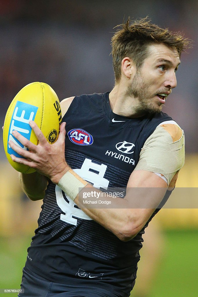 Dale Thomas of the Blues looks upfield uring the round six AFL match between the Carlton Blues and the Essendon Bombers at Melbourne Cricket Ground on May 1, 2016 in Melbourne, Australia.