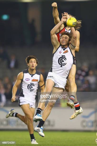 Dale Thomas of the Blues marks infront of Josh Bruce of the Saints during the round eight AFL match between the St Kilda Saints and the Carlton Blues...