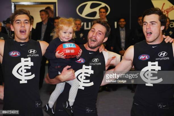 Dale Thomas of the Blues sing the club song after winning with daughter Matilda during the round 12 AFL match between the Carlton Blues and the...