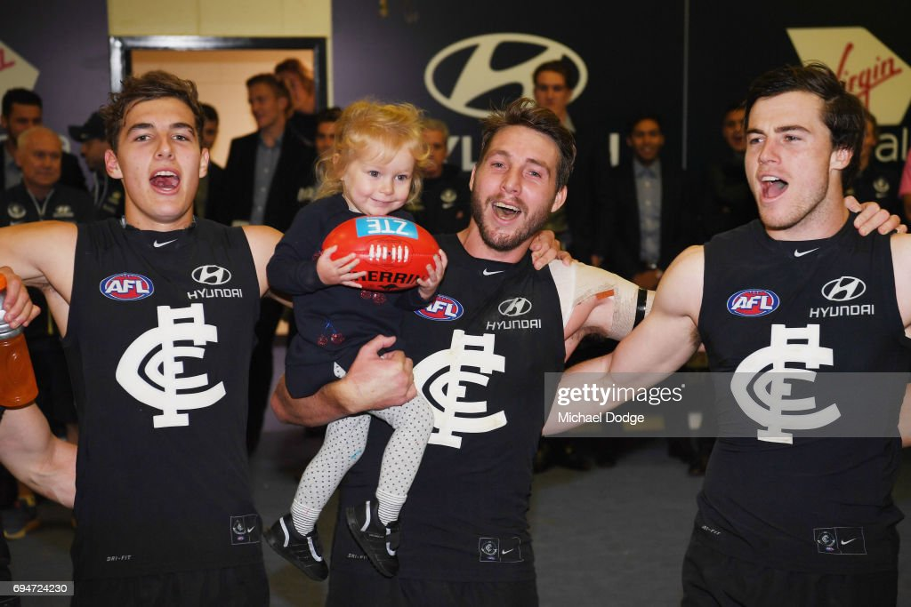 Dale Thomas of the Blues sing the club song after winning with daughter Matilda during the round 12 AFL match between the Carlton Blues and the Greater Western Sydney Giants at Etihad Stadium on June 11, 2017 in Melbourne, Australia.