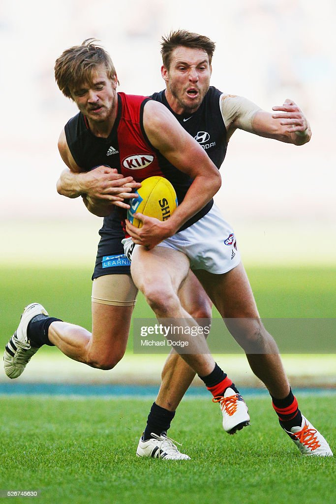 Dale Thomas of the Blues tackles Martin Gleeson of the Bombers during the round six AFL match between the Carlton Blues and the Essendon Bombers at Melbourne Cricket Ground on May 1, 2016 in Melbourne, Australia.