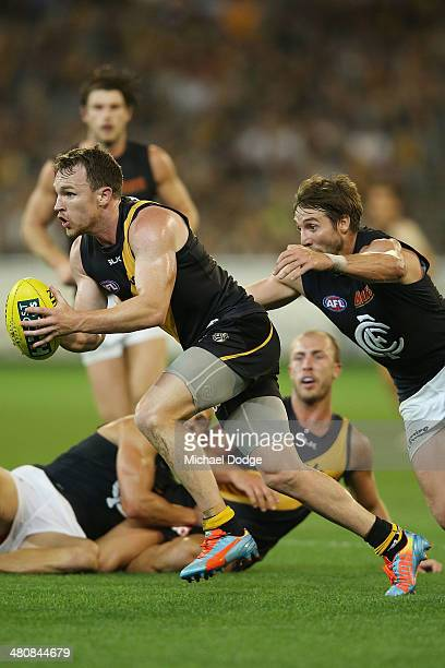 Dale Thomas of the Blues tackles Nathan Foley of the Tigers during the round two AFL match between the Richmond Tigers and the Carlton Blues at...