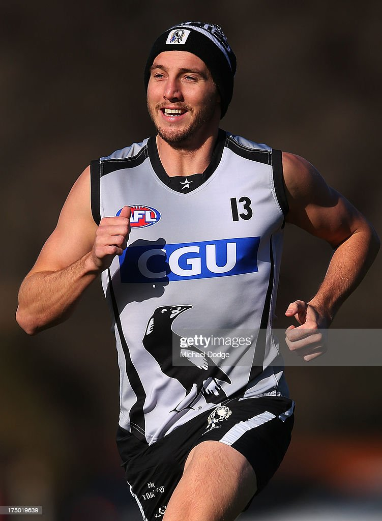 Dale Thomas reacts while running during a Collingwood Magpies AFL training session at Olympic Park on July 30, 2013 in Melbourne, Australia.
