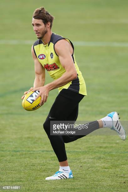 Dale Thomas runs with the ball during a Carlton Blues AFL training session at Visy Park on March 15 2014 in Melbourne Australia